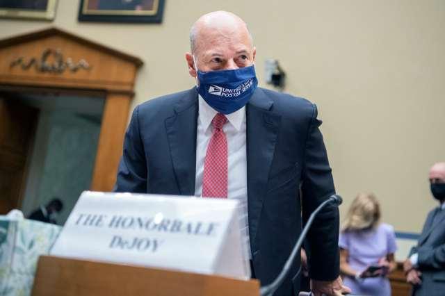 DeJoy arrives speak in the House of Representatives wearing a USPS face mask