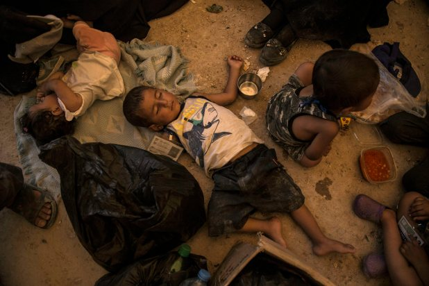 Children sleeping on the ground