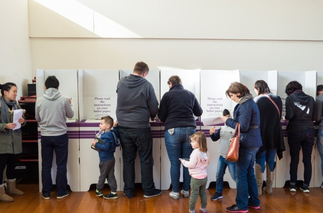 Australians voting at a polling booth.