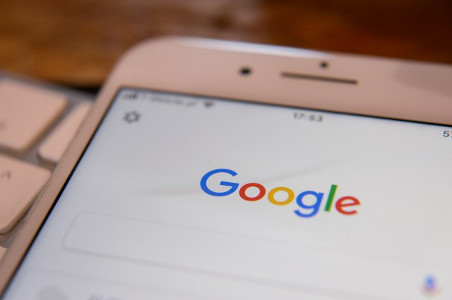 The Google search application is pictured running on an iPhone.