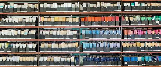 Library shelves full of academic journals.