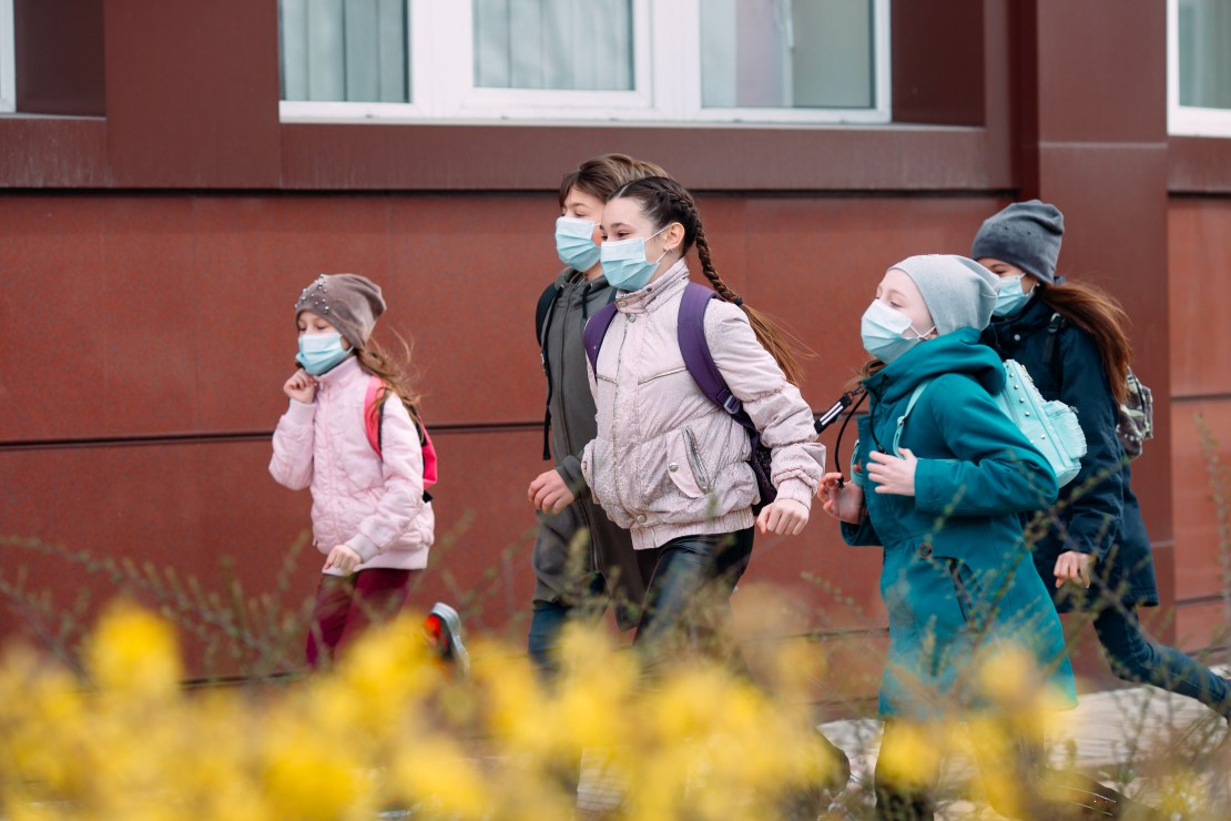 Children in masks leaving school