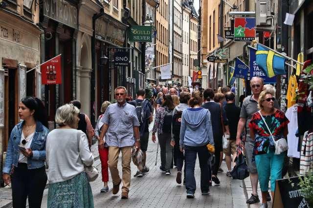 Crowds walking down street in Stockholm.