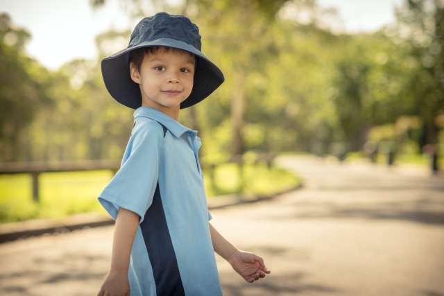 Young boy in school uniform.