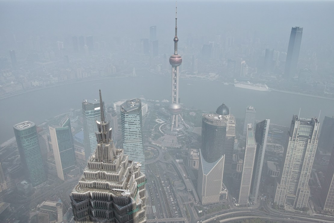 Skyscrapers viewed from above through smog.