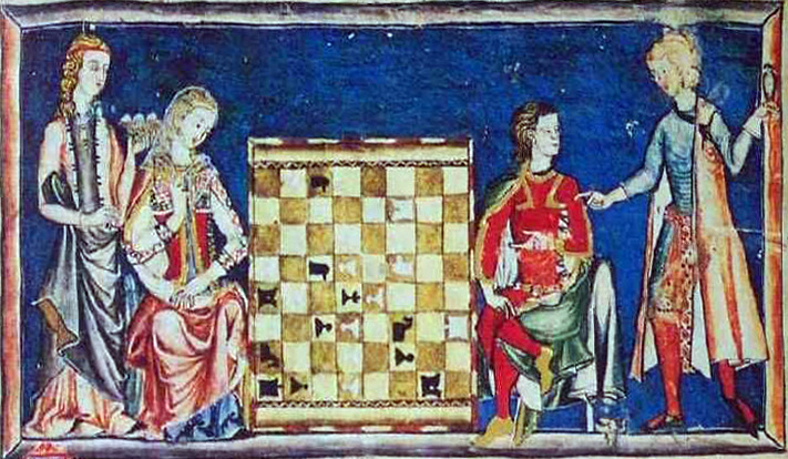 A young man and woman play chess while two other women look on.