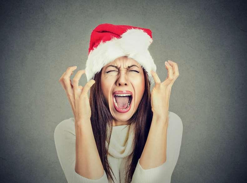Woman screaming wearing Santa hat