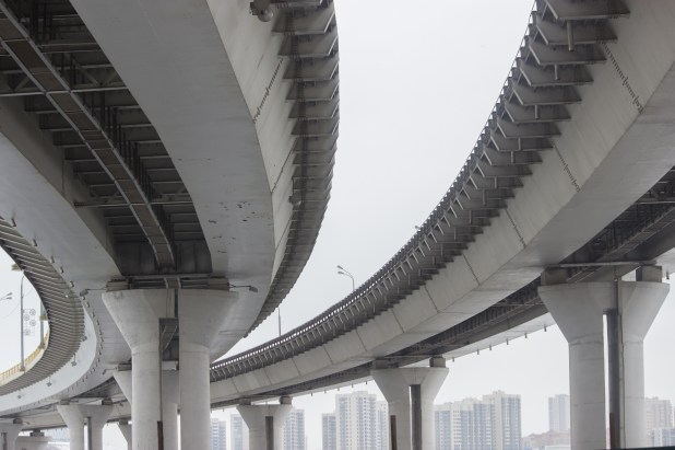 A concrete highway bridge viewed from below.