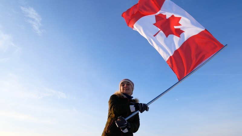 Woman waving Canadian flag
