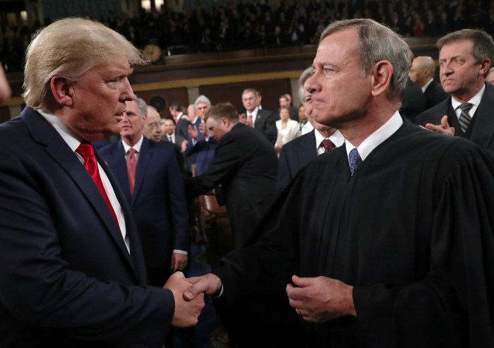 Chief Justice John Roberts and President Trump shake hands at the Feb. 4, 2020 State of the Union address.