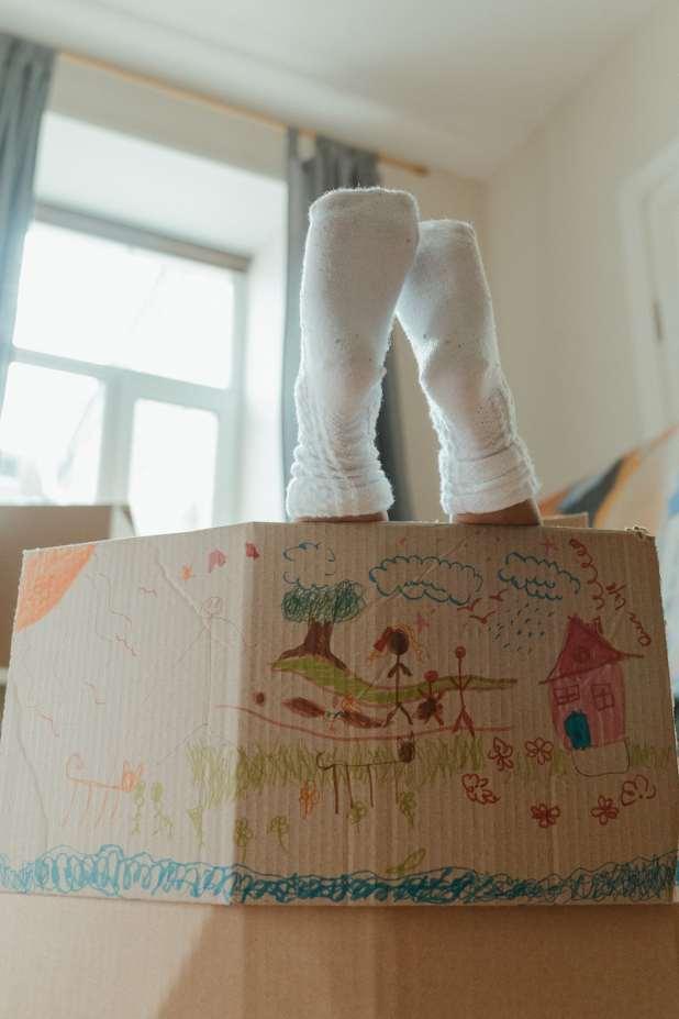 A kid in a box.