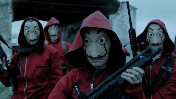 Robbers in red hoodies and masks.