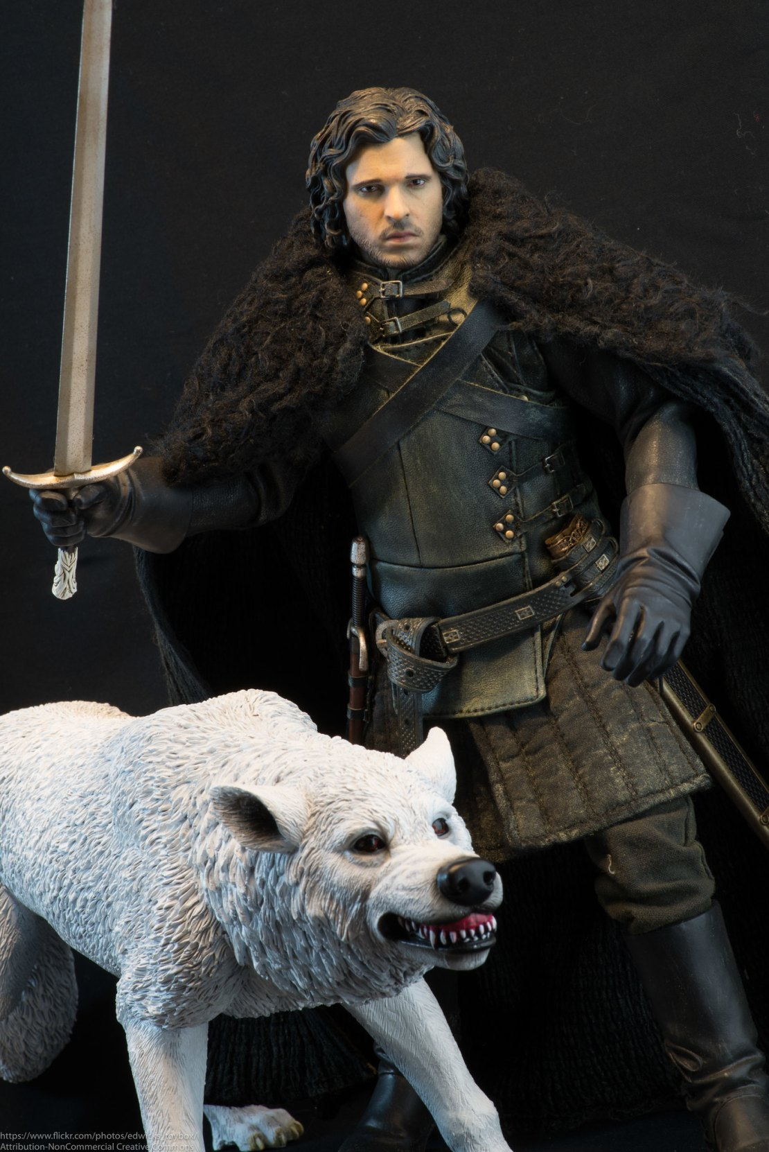 Jon Snow from Game of Thrones with his dire wolf.