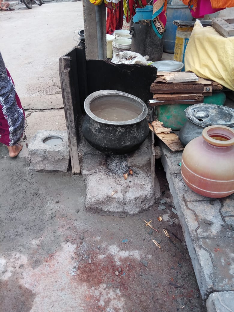 Picture of a pot on an open stove.