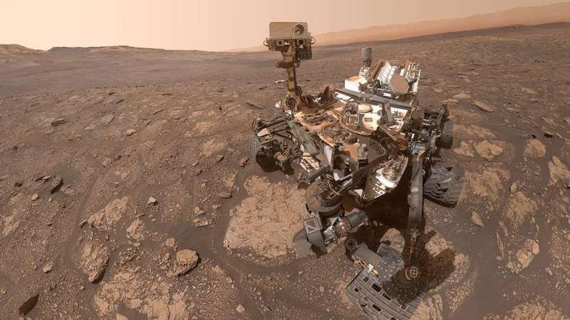 The Curiosity rover on the Martian surface.