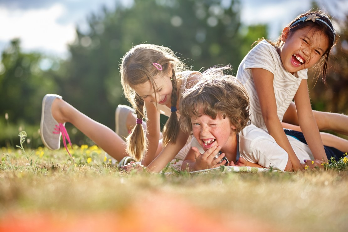 Image of happy children playing and having fun in summer.