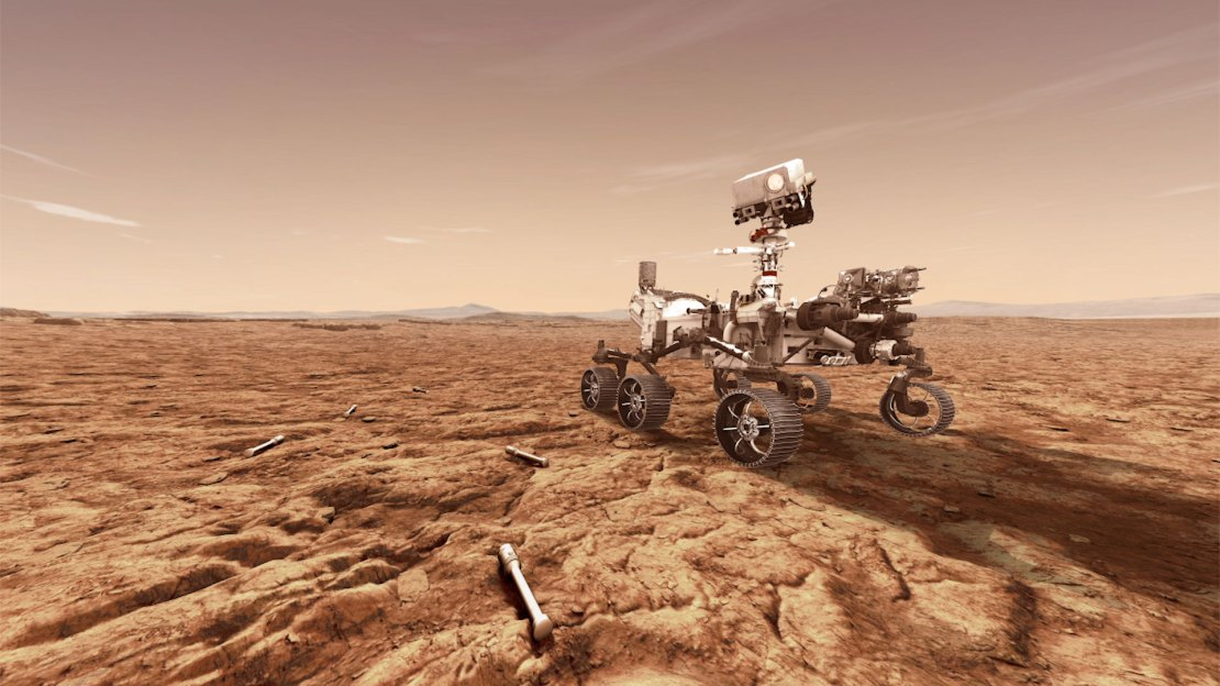 Artist's impression showing the rover on Mars with sample tubes around it on the ground.
