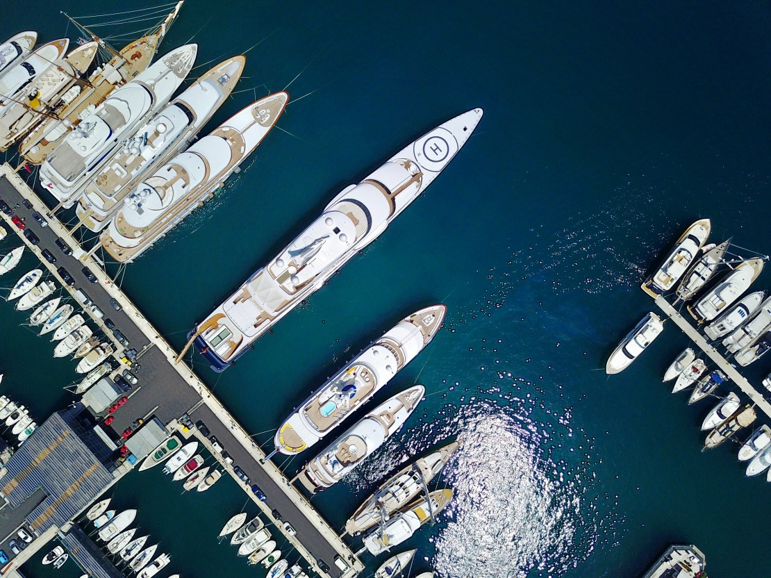 Megayachts in a harbour viewed from above.