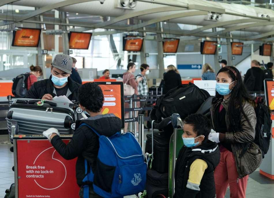 Travellers wearing masks