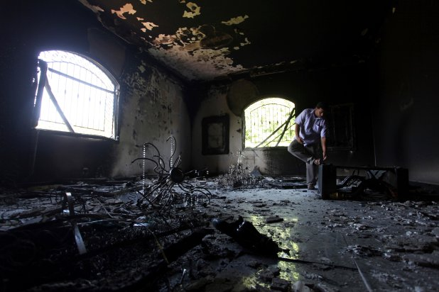A man looks at the ruins of the U.S. Consulate building