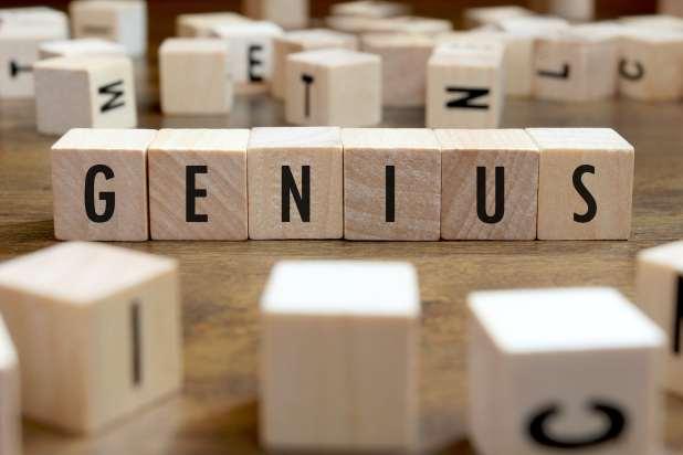 Genius word written on wood block.