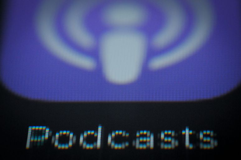 A zoom-in of Apple's purple podcast icon.