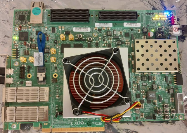a fan on top of a metal square in the middle of a computer circuit board