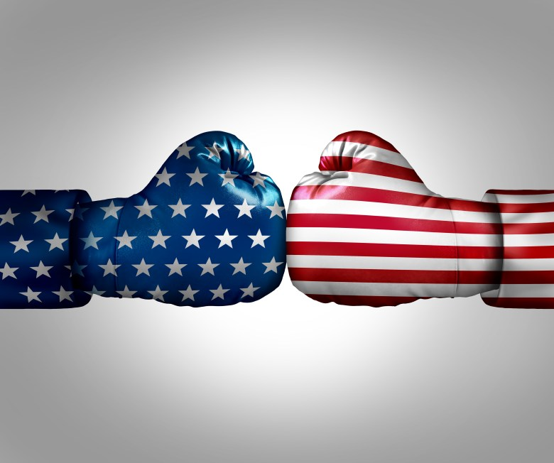 Two boxing gloves that represent Red and Blue America, pushing against each other.