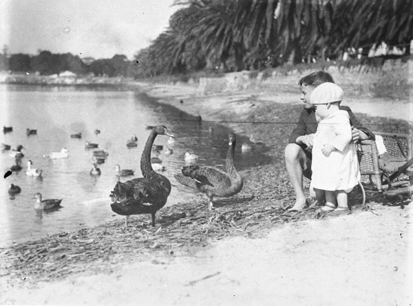 black and white photo of kids at lake with birds