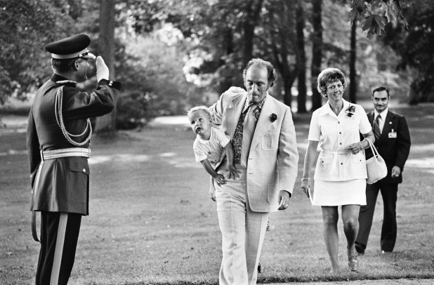 Pierre Trudeau carries a baby Justin Trudeau.