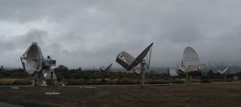 A group of satellite dishes pointing in various directions.