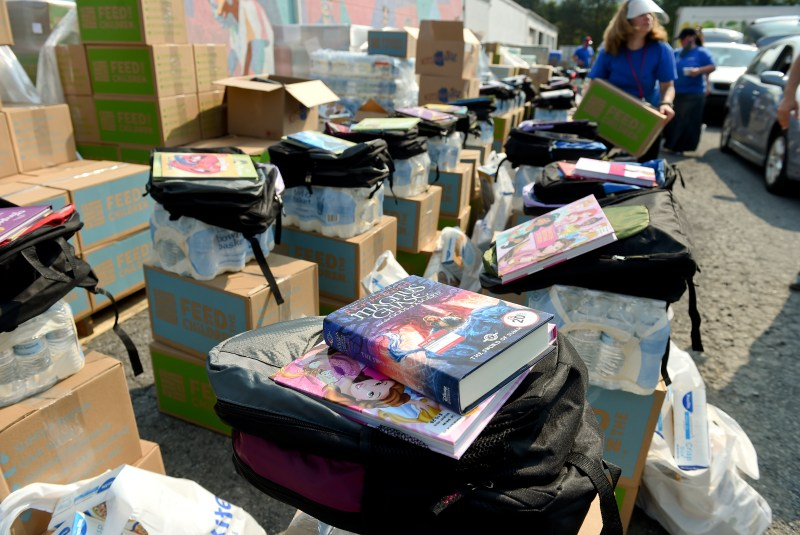 Colorful stacks of books, backpacks and other school supplies