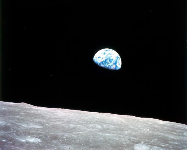 A view of Earth rising from the Moon.
