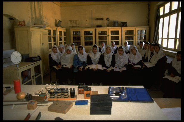Afghan girls study science at a government-run girl's high school.