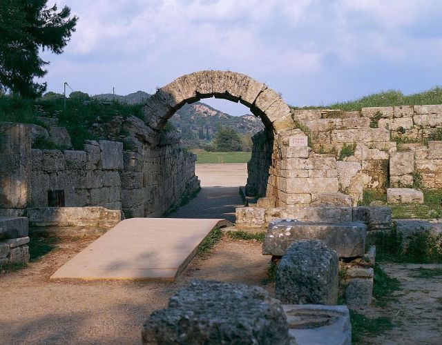 The ruins – which include an intact section of the arched entrance tunnel – of the Greek Stadium of Olympia