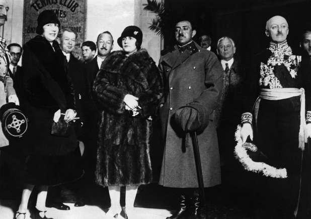 King Amanullah Khan and Queen Soraya Tarzi Hanim arrive at a railway station.