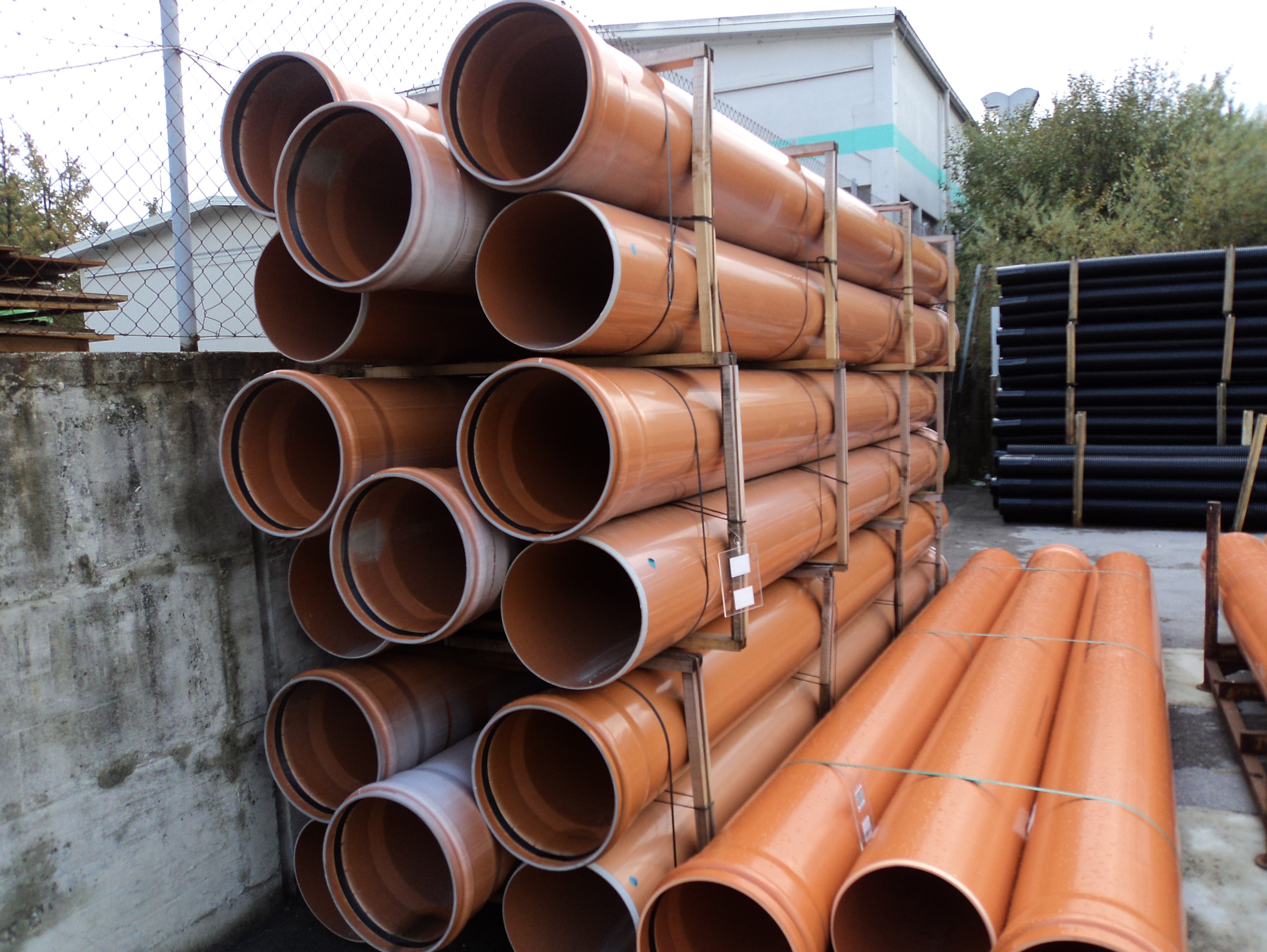 A stack of reddish plastic pipes.