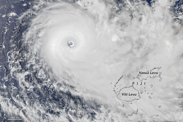 Satellite view of a hurricane with outlines of the islands in its path