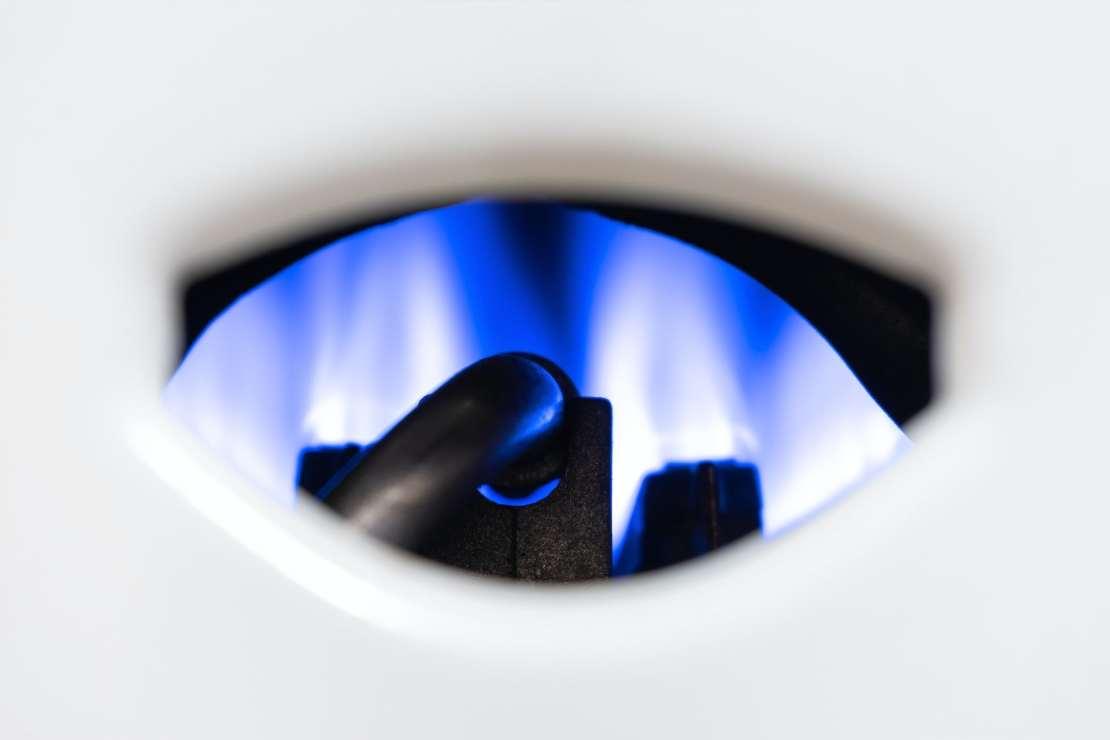 The blue pilot light of a gas boiler.