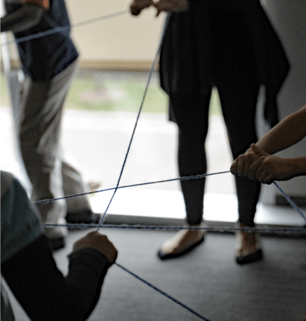An ice-breaker exercise involving tossing strings of yarn to one another