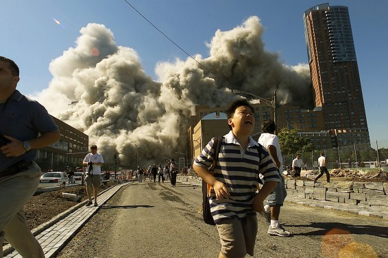 In lower Manhattan near Ground Zero, people run away as the North Tower of the World Trade Center collapses.