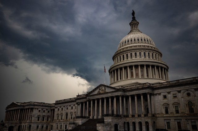 The U.S. Capitol, against a stormy sky background.