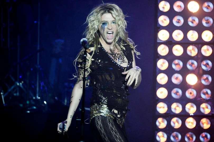Kesha onstage wearing black.