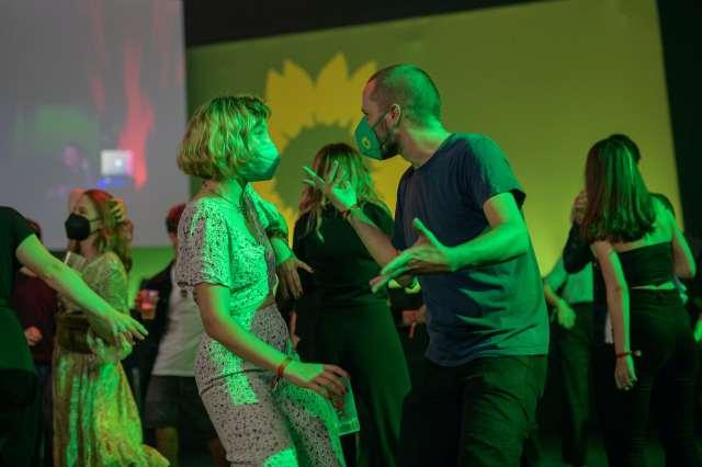 Greens supporters dancing.
