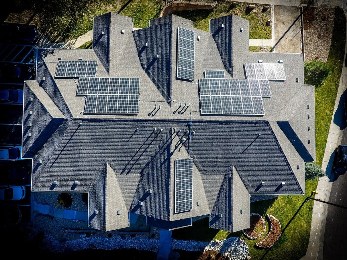 A bird's eye view of a roof with solar panels