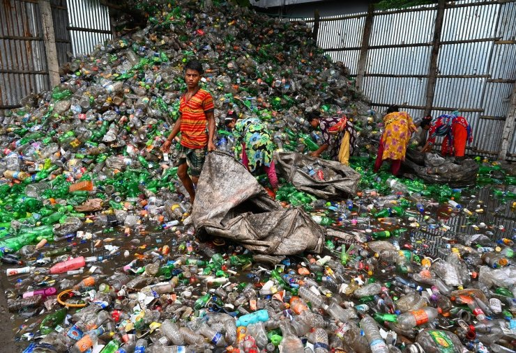 People pick waste from a landfill