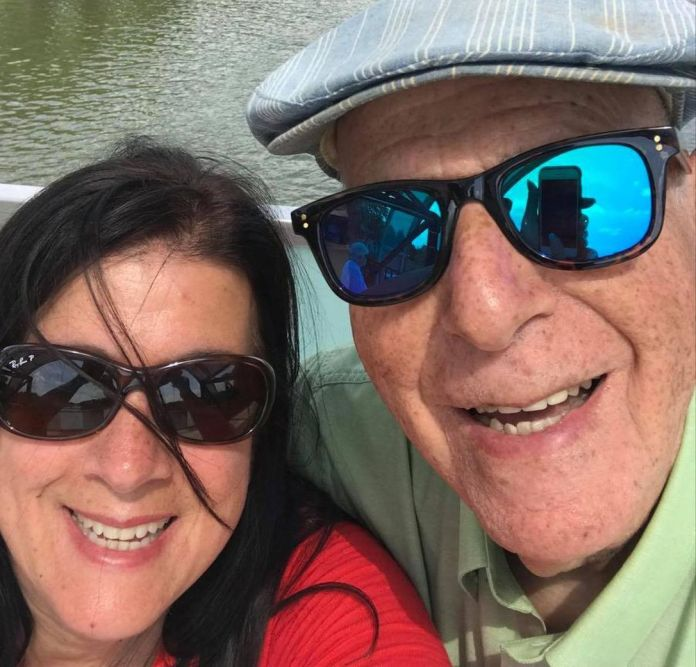 Patsy Nunes with her dad Harry Mamlin in Cambridge. She and her husband John both got mixed vaccine doses and are unsure whether they will be allowed to visit her aging parents in North Carolina under the new border reopening plan.