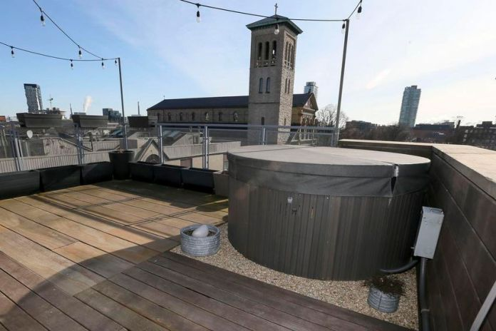 The roof of the five-story house offers views of the city and a hot tub.