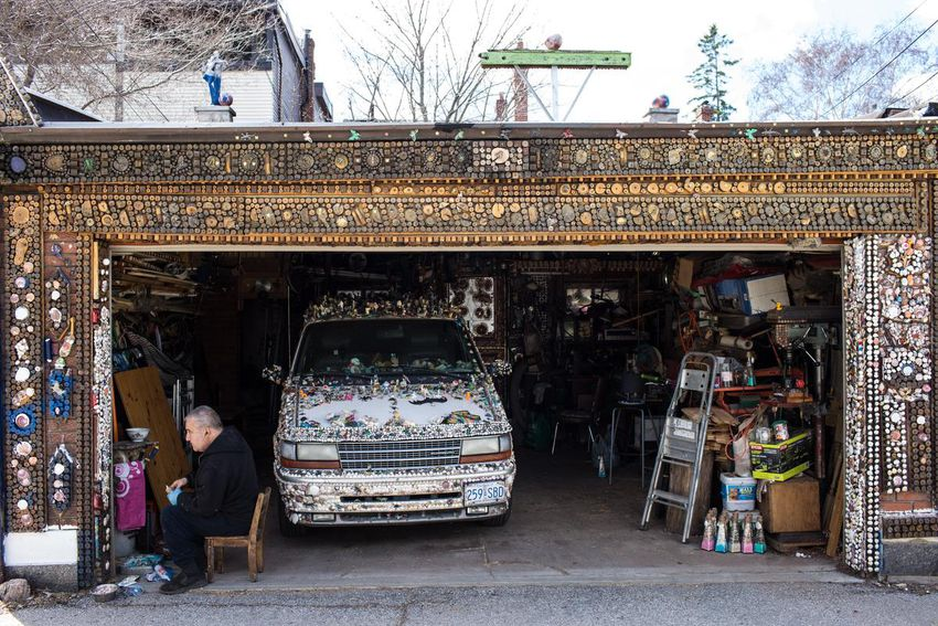 garage overview - He drives a van covered in plastic bugs. And he's made Toronto's most eccentric garden his life's work