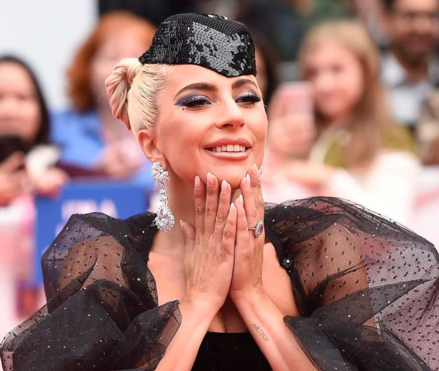 Lady Gaga Poses On The Toronto Red Carpet For A Star Is Born On Sept